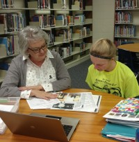 Student and Linda Smith meeting in Jr. High Media Center
